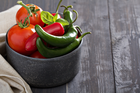 hot peppers: Green and red hot peppers on table Stock Photo