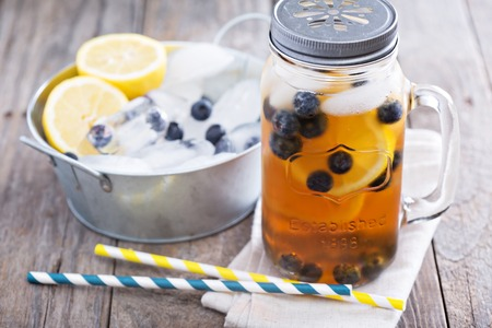jars: Ice tea with lemon and blueberries Stock Photo