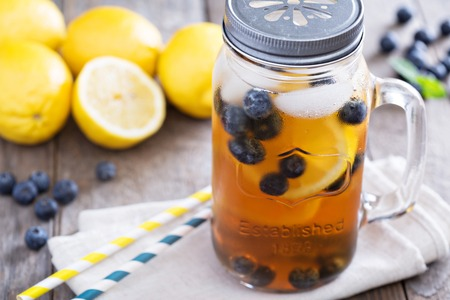 lemon slices: Ice tea with lemon and blueberries Stock Photo