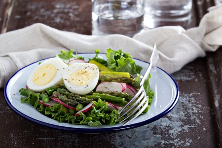 Fresh salad with lettuce, asparagus and eggs