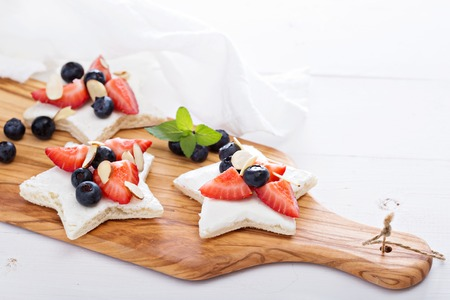 star shaped: Star shaped sandwiches with berries and cheese Stock Photo