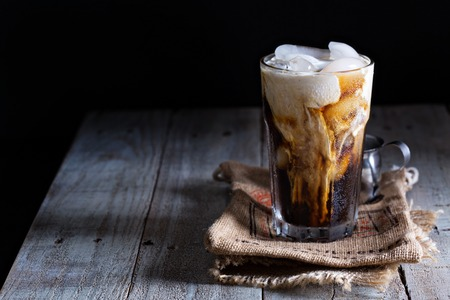 coffee table: Iced coffee in a tall glass Stock Photo