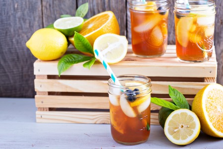 Homemade iced tea in mason jars with straws
