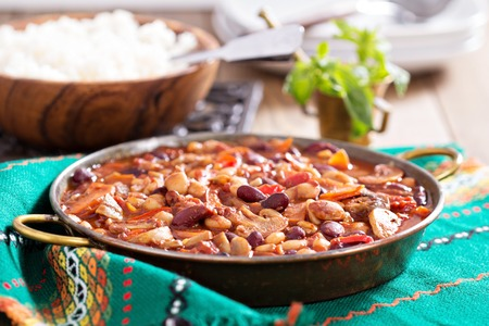 chili sauce: Vegan chili with beans, mushrooms, and vegetables