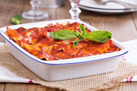 Vegan tofu lasagna with tomato sauce and basil