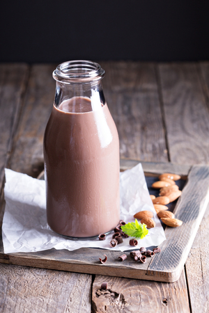 Homemade almond chocolate milk in a bottle