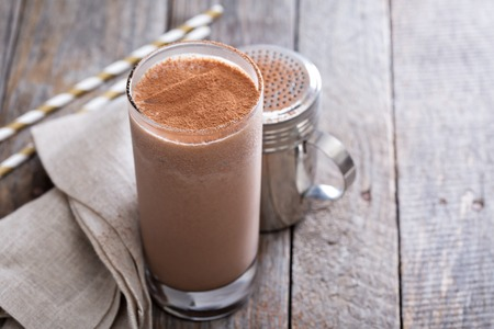 Cold chocolate milkshake in tall glass with ice Stock Photo
