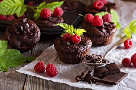 muffin: Chocolate raspberry yogurt muffins with pieces of chocolate and muffin tin Stock Photo