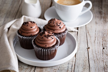 Chocolate cupcakes with a cup of hot black coffee 스톡 콘텐츠
