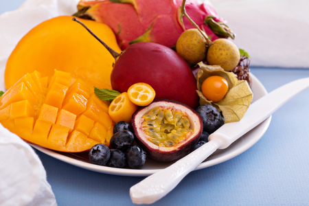 fruit plate: Variety of exotic fruits on white plate