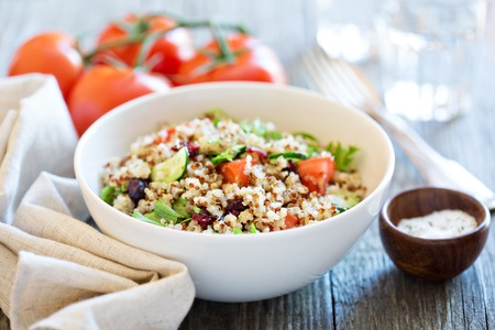 red quinoa: Quinoa salad with fresh tomatoes, cucumbers and salad leaves