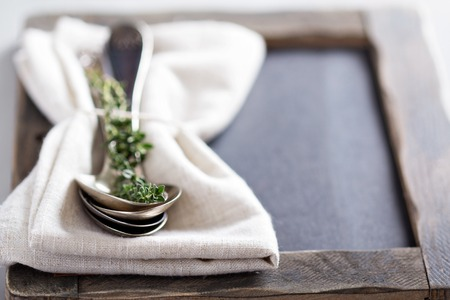 sprigs: Tablespoons with a napkin and sprigs of thyme Stock Photo