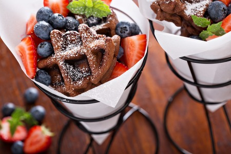 Small chocolate waffles with berries for dessert