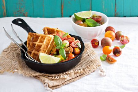 and savory: Savory waffles with cheese and cornmeal served with tomato salsa