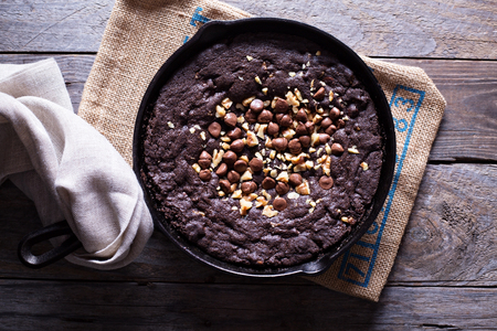 Chocolate giant skillet cookie with walnuts and milk chocolate chips