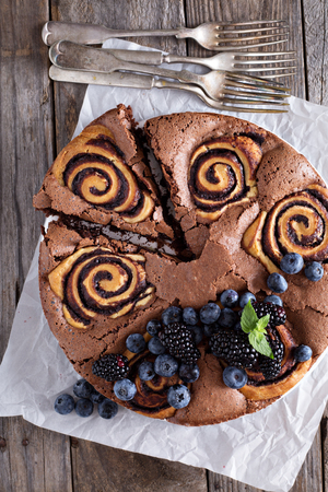 recipe decorated: Chocolate cake with sweet chocolate cinnamon rolls inside
