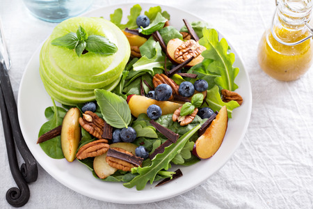 Fresh healthy salad with leafy greens, plums, nuts and apple Stok Fotoğraf - 45656608