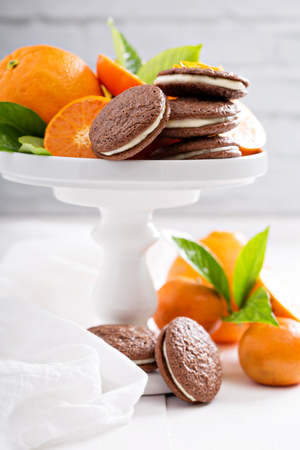 Chocolate orange thin brownie cookies with cream filling
