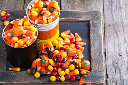 tins: Halloween candy in small tins on brown rustic table