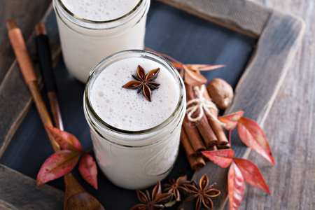 frothy: Warm frothy milk with syrup and winter spices Stock Photo