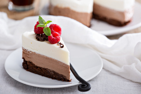 layer cake: Three chocolate mousse cake slice on a small plate