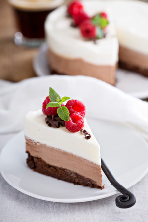 small plate: Three chocolate mousse cake slice on a small plate
