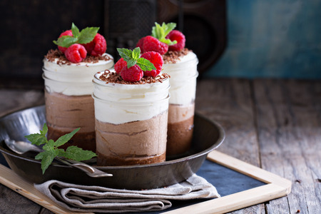 black dish: Three chocolate mousse dessert in mason jars
