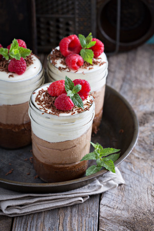 Three chocolate mousse dessert in mason jars Stock Photo - 46291222