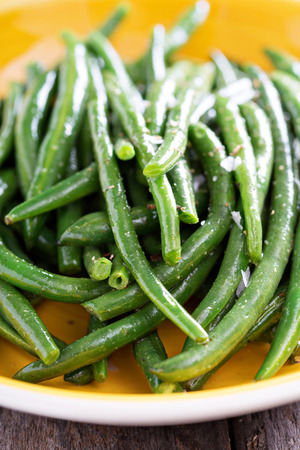 side order: Sauteed green beans with salt and pepper on big plate Stock Photo