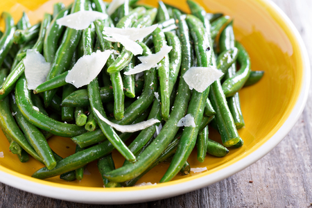 greenbeans: Sauteed green beans with parmesan cheese on big plate Stock Photo