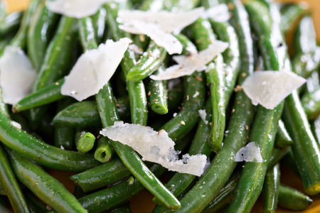 green beans: Sauteed green beans with parmesan cheese on big plate Stock Photo