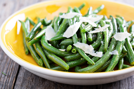 side order: Sauteed green beans with parmesan cheese on big plate Stock Photo