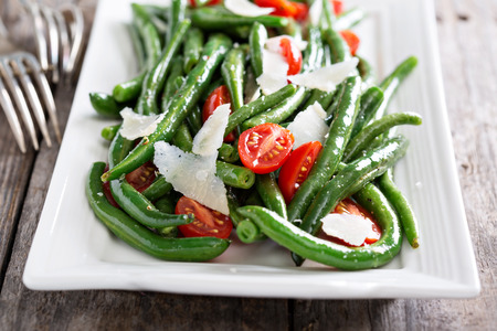 Warm salad with green beans, tomatoes and parmesan cheese
