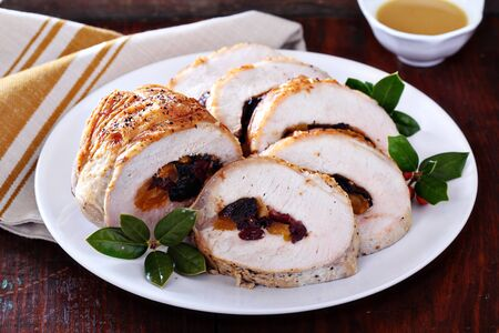 Roasted pork loin stuffed with dried fruits for Christmas table