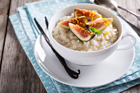 Rice pudding with milk and vanilla beans garnished with figs