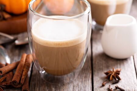 Pumpkin spice latte with spices and pumpkin puree