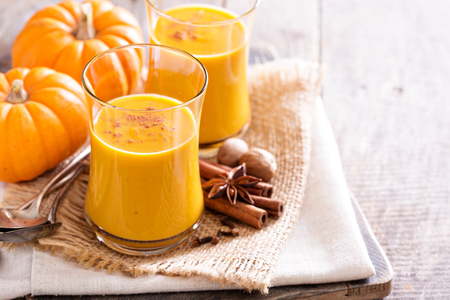 raw tea: Pumpkin and orange spiced fall drink with cinnamon Stock Photo