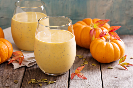 Healthy pumpkin smoothie with chia seed in glasses on rustic background Reklamní fotografie