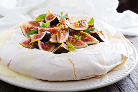 Pavlova cake with fresh figs, white chocolate, ricotta cream and orange zest 写真素材