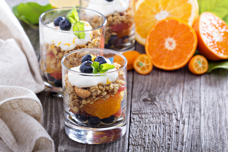 compote: Granola breakfast parfait with citrus compote and blueberries Stock Photo