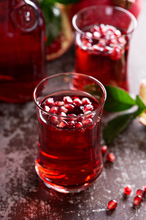 sparkling water: Pomegranate drink with sparkling water fall cold beverage