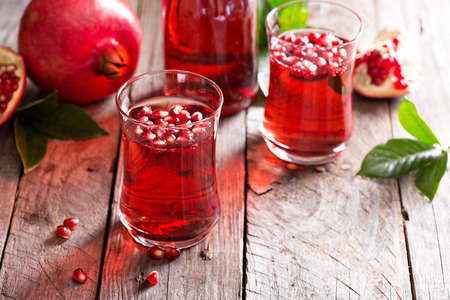 saludable: Pomegranate drink with sparkling water fall cold beverage