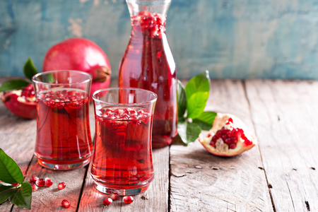 pomegranates: Pomegranate drink with sparkling water fall cold beverage