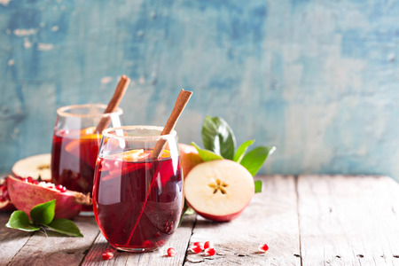 Fall and winter sangria with apples, oranges, pomegranate and cinnamon