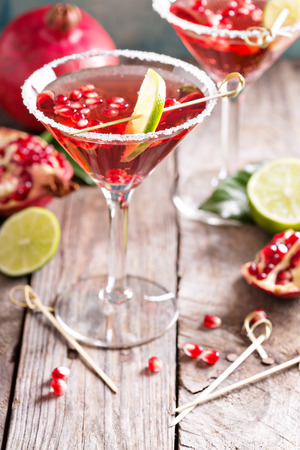 Pomegranate martini with slices of lime and pomegranate seeds Stok Fotoğraf
