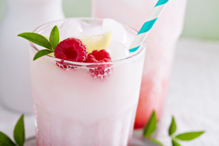 Italian soda drink with berry syrup and coconut milk
