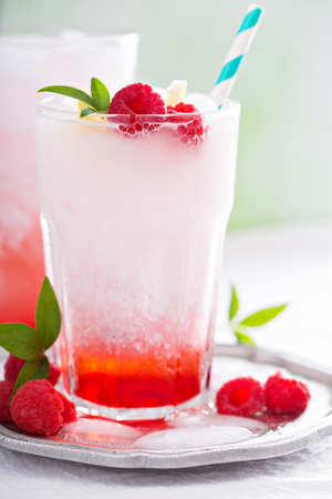 carbonation: Italian soda drink with berry syrup and coconut milk