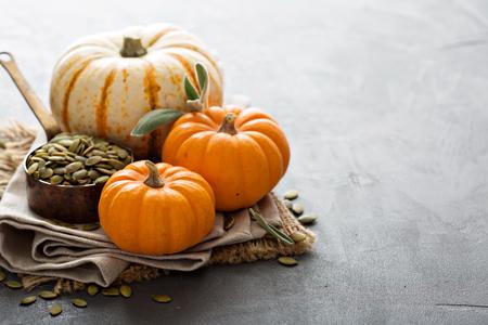 Pumpkins with pumpkin seeds and sage leaves