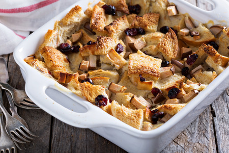 Bread pudding breakfast casserole with pear and dried cranberry