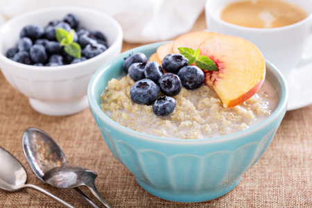 Breakfast quinoa porridge with fresh fruits in a bowl